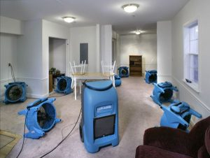room with various water damage restoration equipment in it